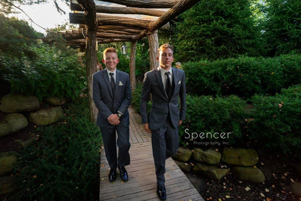 groomsmen entering wedding reception at Thorncreek Winery