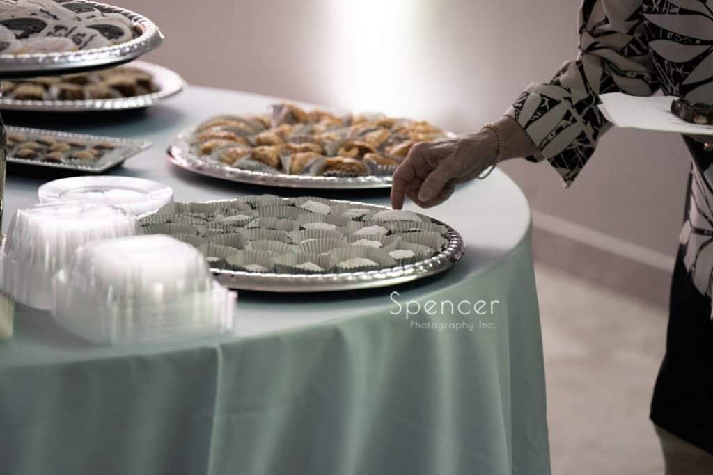 woman grabbing cookie at reception St. Demetrios Banquet Facilities