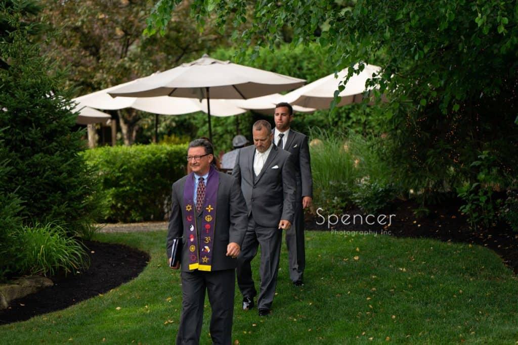 groom walking to wedding ceremony at Thorncreek Winery