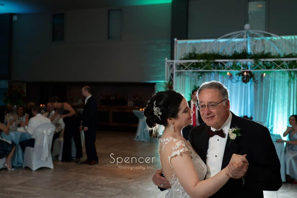 bride dancing with her dad at wedding reception at St. Demetrios