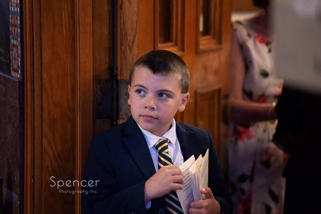 little boy passing out wedding programs at St. Demetrios
