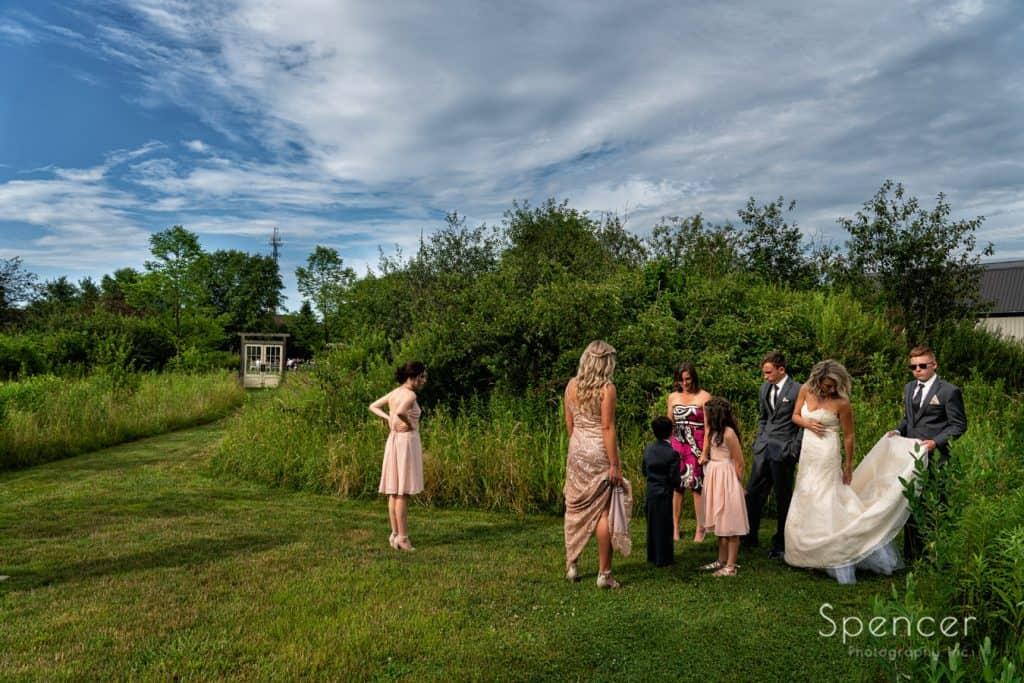 wedding party preparing to walk to wedding ceremony at Thorncreek