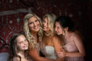 bride laughing with bridesmaids at The Bertram