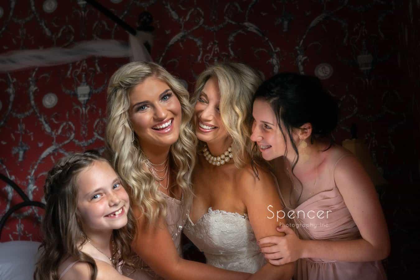 bride laughing with bridesmaids at The Bertram