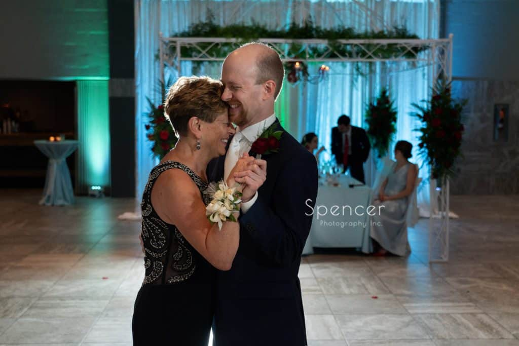 groom dancing with mom at wedding reception at St. Demetrios