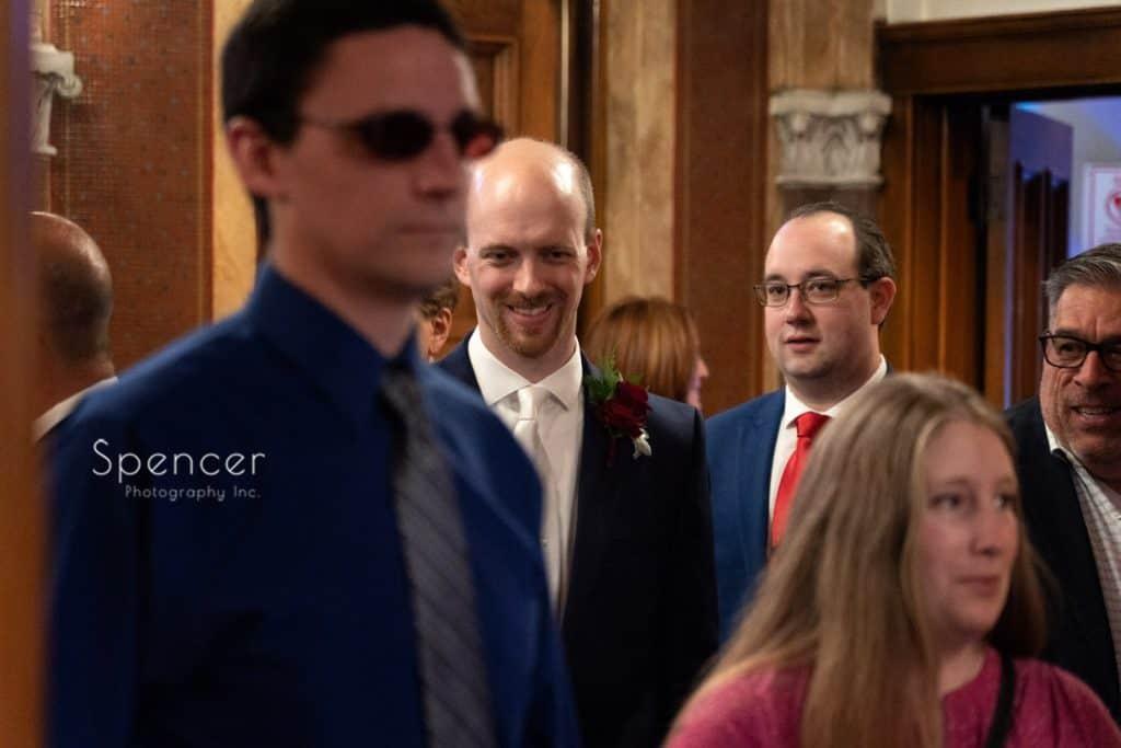 groom entering wedding ceremony at St. Demetrios