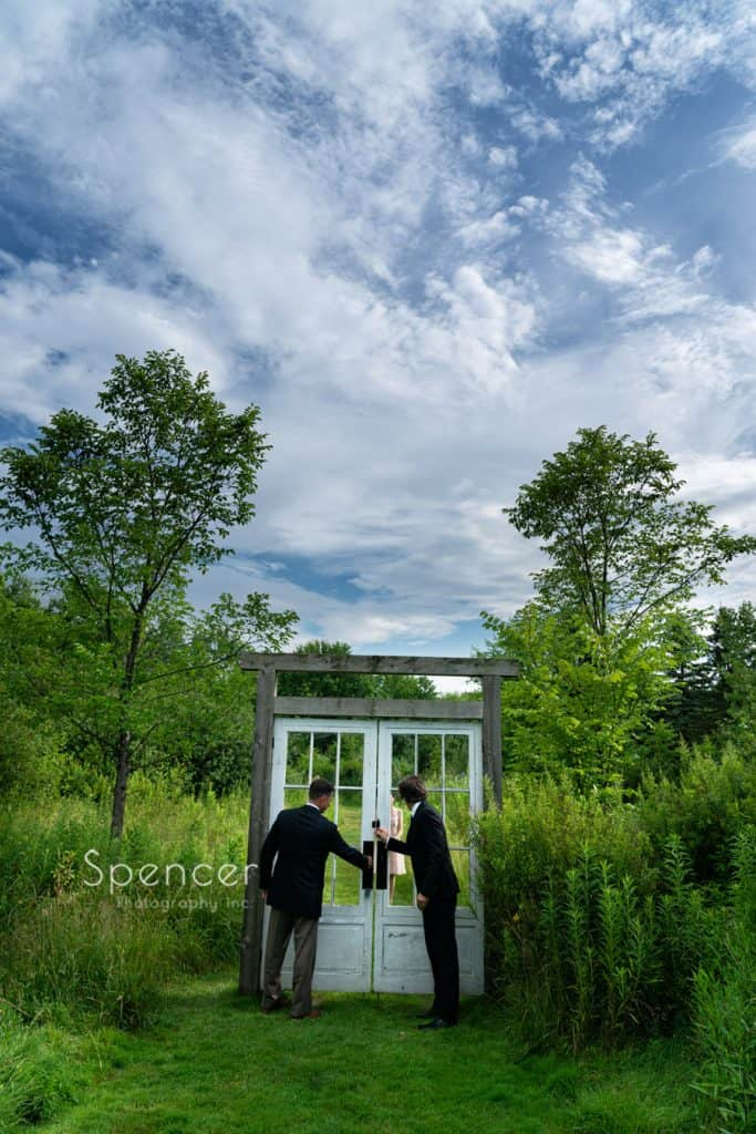 opening the doors to outdoor wedding ceremony at Thorncreek