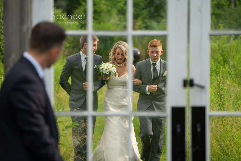 bride walking to her outside wedding ceremony at Thorncreek Winery