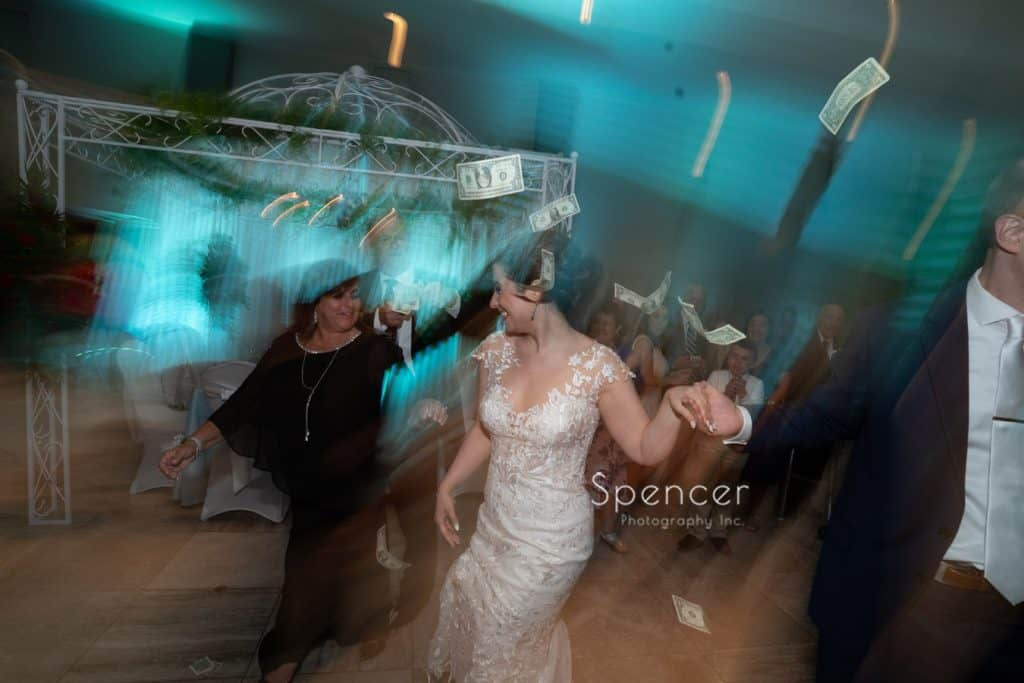 bride dancing at her greek wedding reception