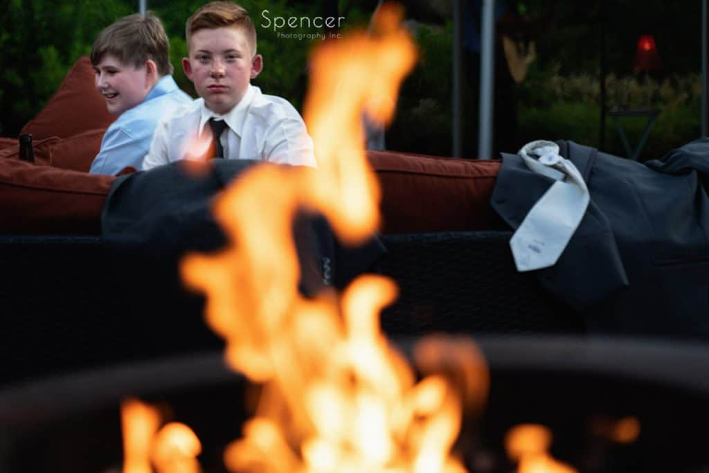 groomsmen relaxing by fire at Thorncreek Winery