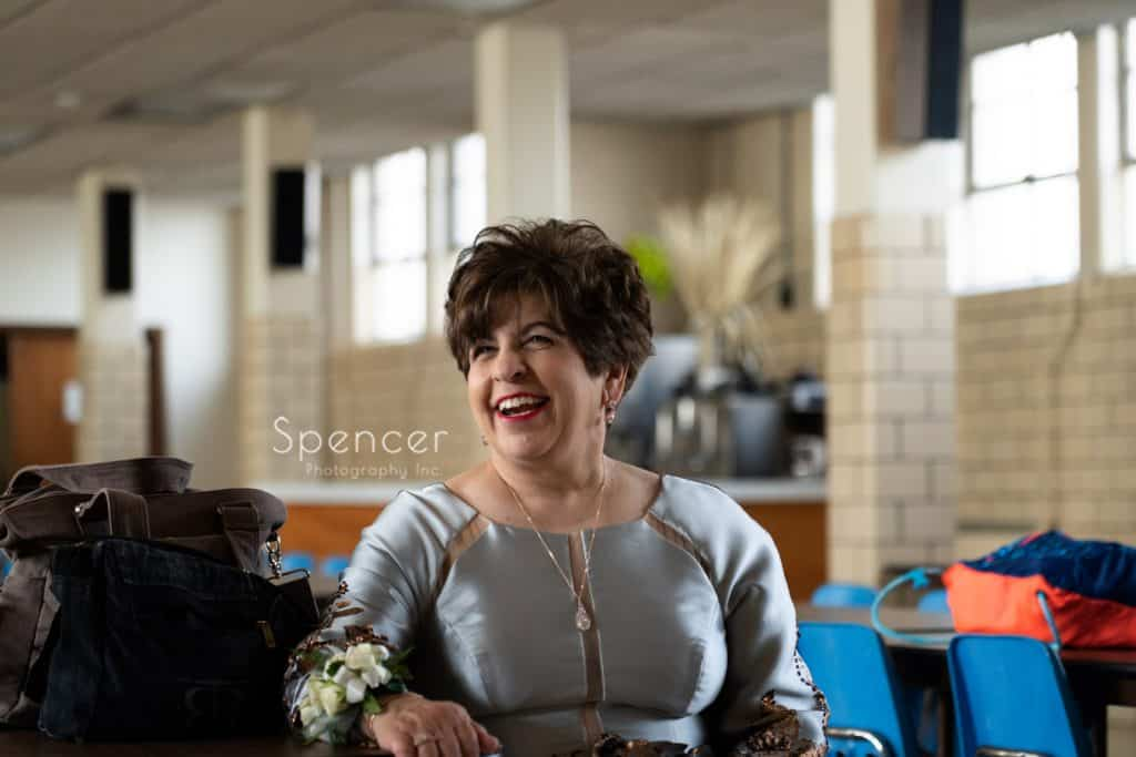 mother of bride laughing before wedding ceremony at St. Demetrios