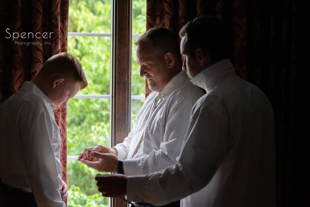 groomsmen getting ready for wedding day at The Bertram Inn