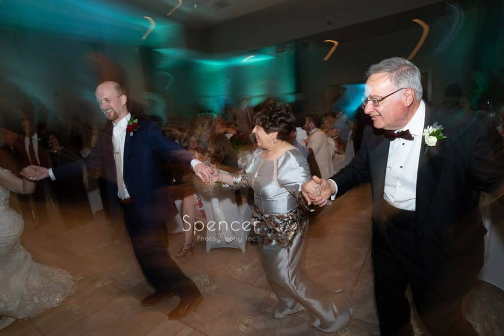 groom dancing with brides parents at St. Demetrios