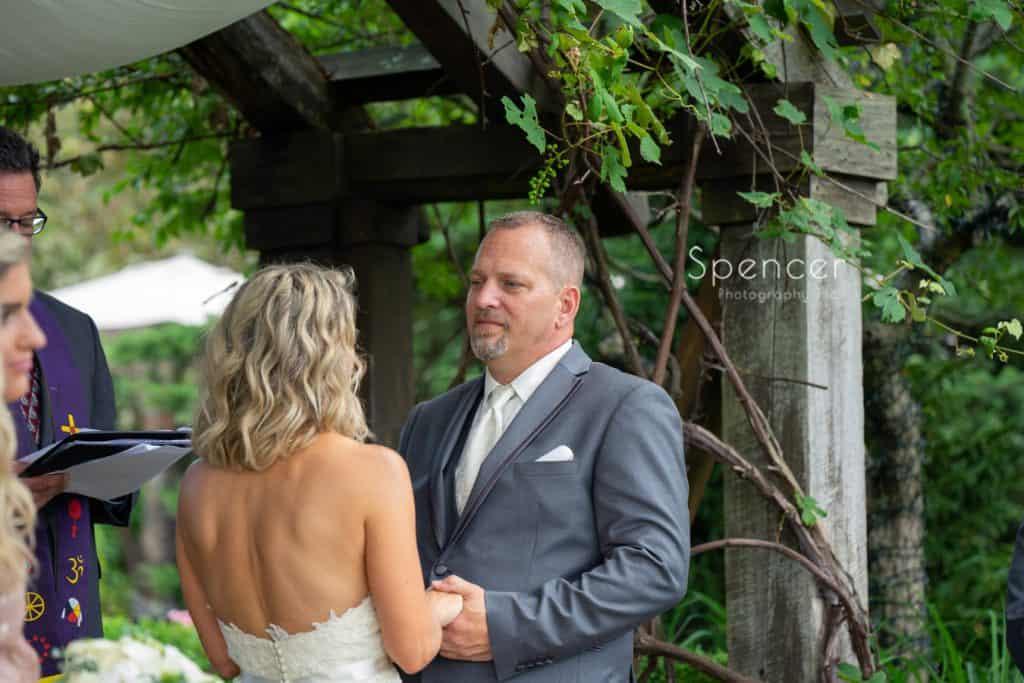 groom saying wedding vows at Thorncreek Winery