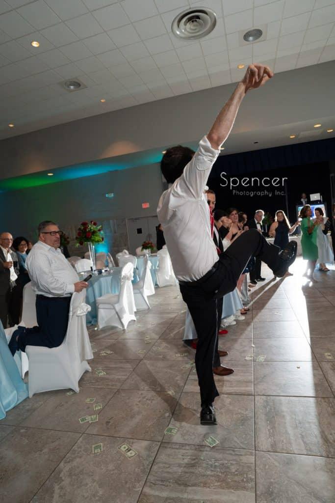 man high kicks at greek wedding reception