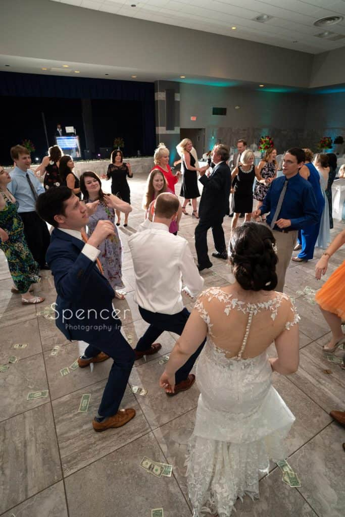 groom dancing at his wedding reception at St. Demetrios Hall