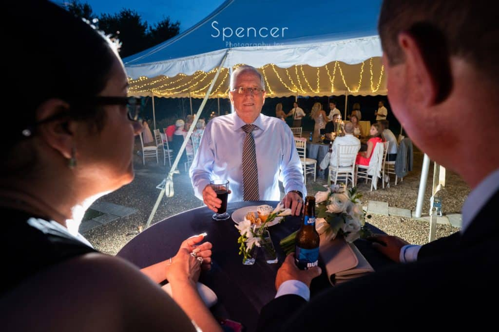 brides father having a beer at her wedding reception at Thorncreek