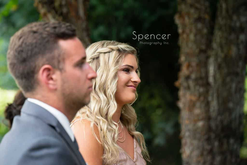 maid of honor watching bride at wedding at Thorncreek