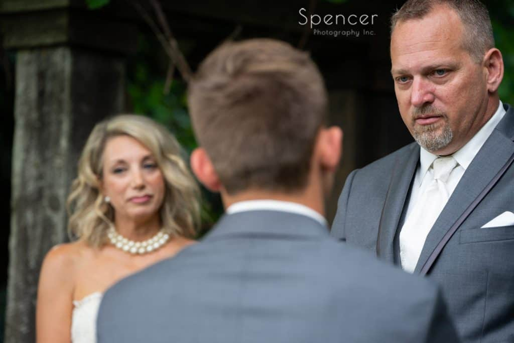 groom reading vows to son at wedding at Thorncreek