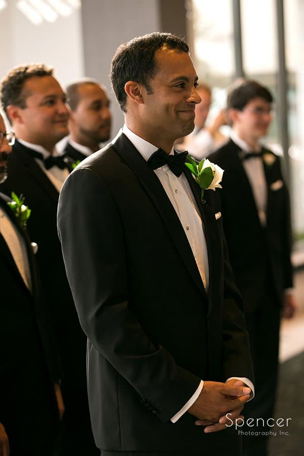 groom watching bride walk down wedding aisle at Landerhaven ceremony