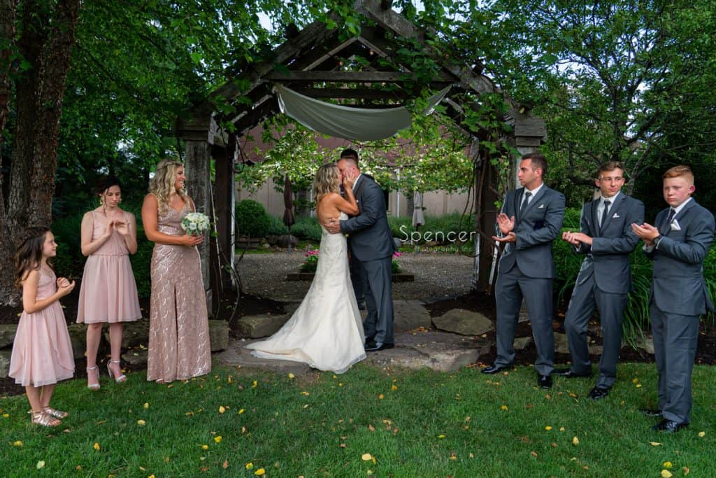bride and groom kiss after wedding ceremony at Thorncreek Winery