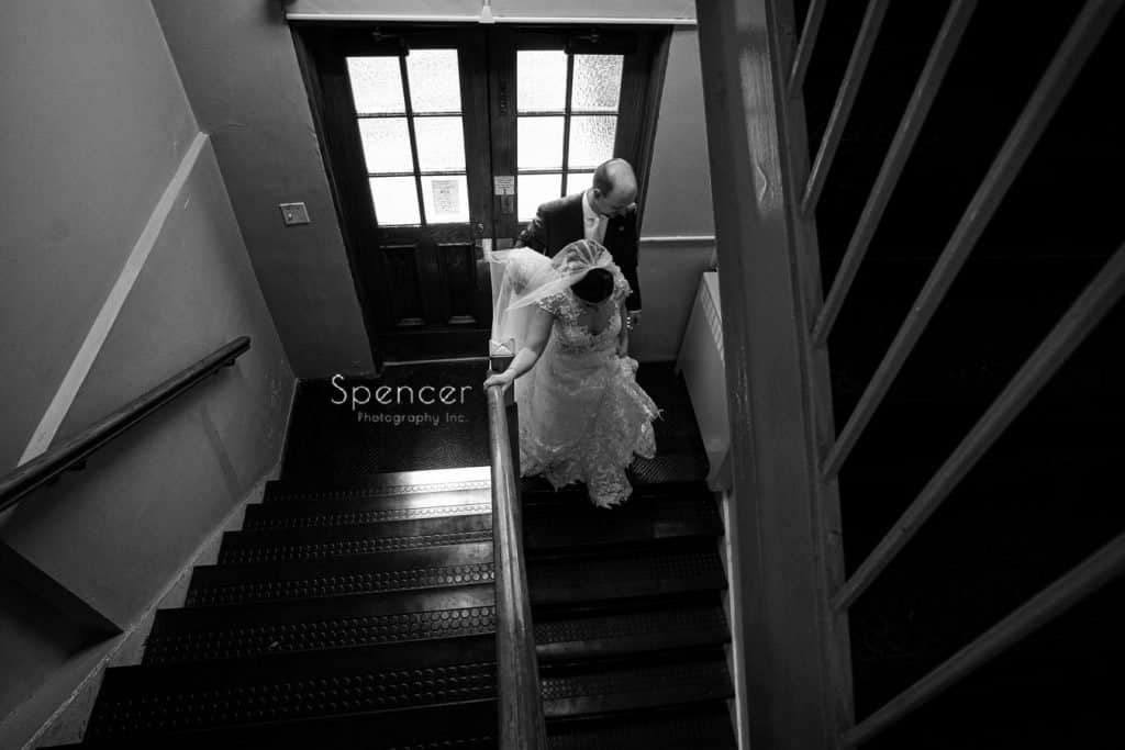 bride and groom walking down stairs after St. Demetrios wedding