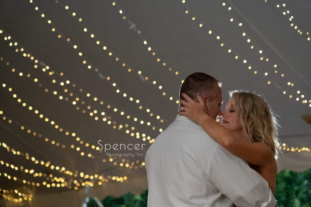 bride kissing groom after first dance at Thorncreek wedding reception
