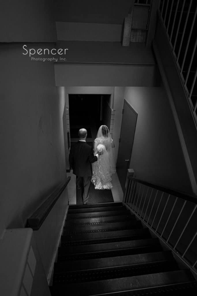 black and white picuture of bride and groom after wedding ceremony