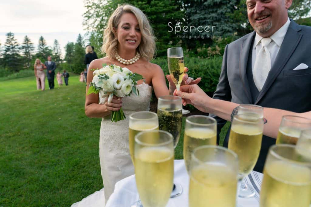 bride getting champagne after wedding ceremony at Thorncreek Winery
