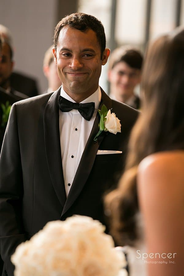 groom smiles at bride at wedding altar at Landerhaven
