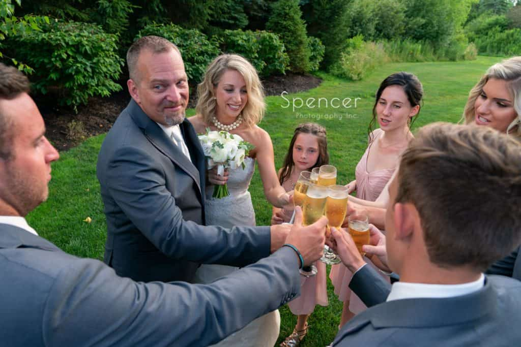 wedding party cheering with champagne at Thorncreek