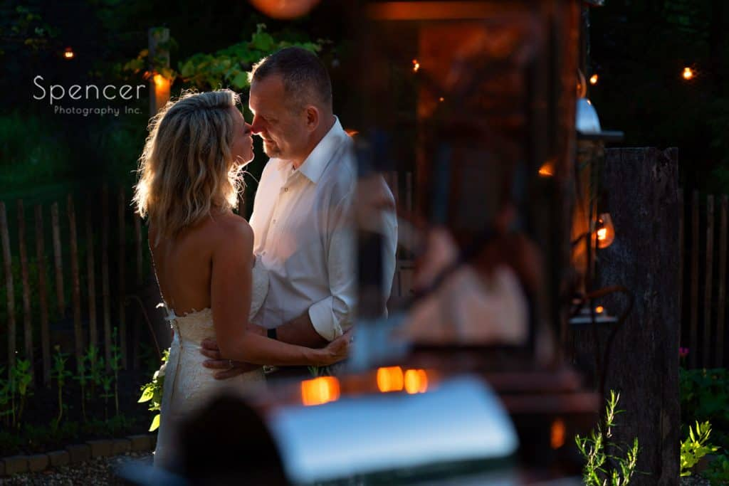 bride and groom kissing in Gardens at Thorncreek
