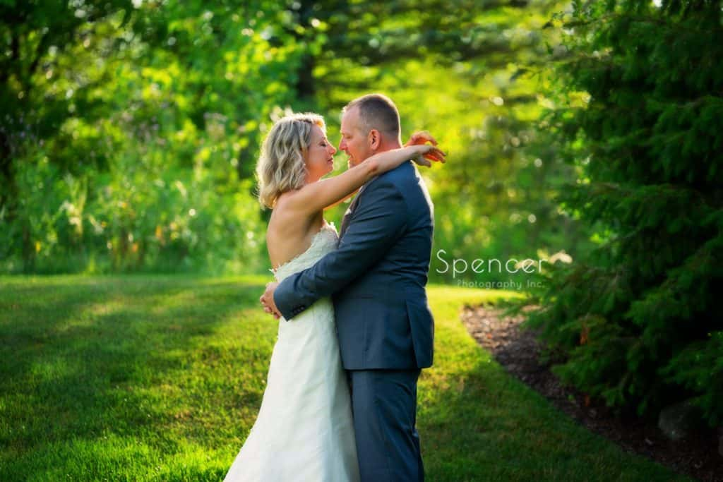 creative picture of bride and groom hugging at Thorncreek Winery