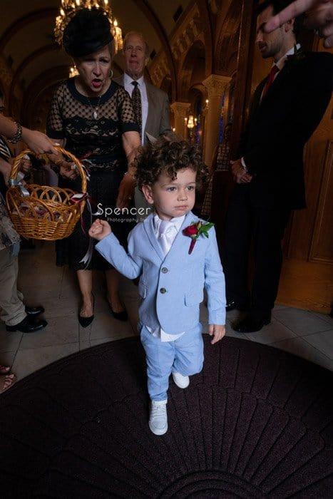 little boy exits greek wedding ceremony at St. Demetrios