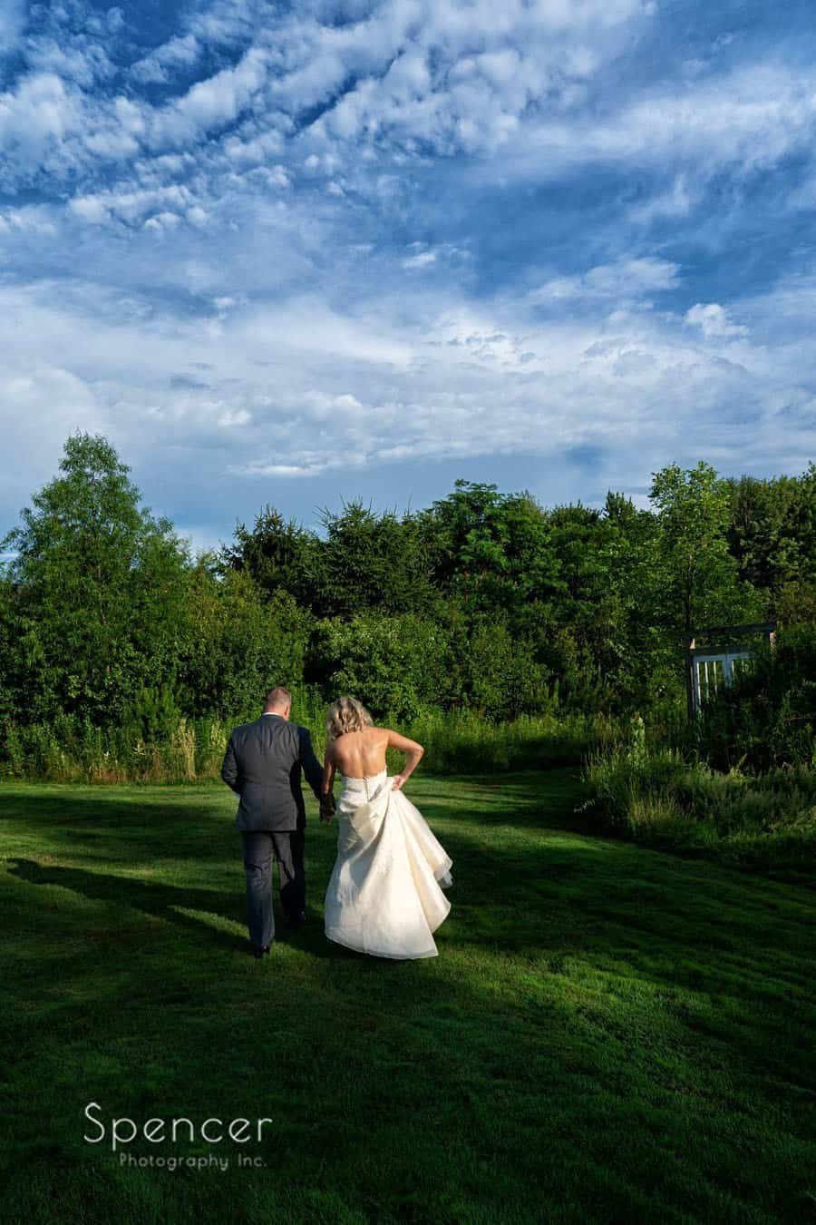 bride and groom walking the grounds of Thorncreek winery