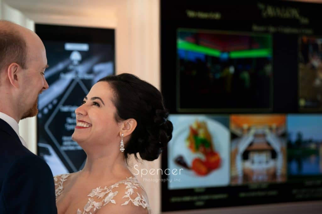 bride smiling at groom on wedding day at Avalon Resort and Spa