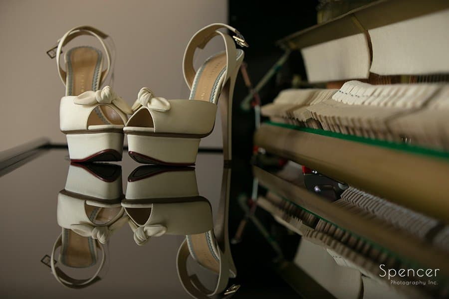 creative picture of brides wedding shoes on piano