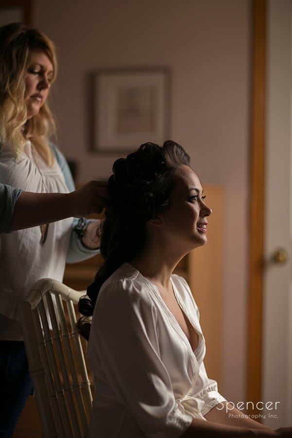 bride getting hair done before her wedding ceremony at Landerhaven