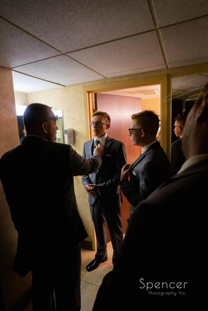 groomsmen preparing to leave for wedding at The Bertam Inn