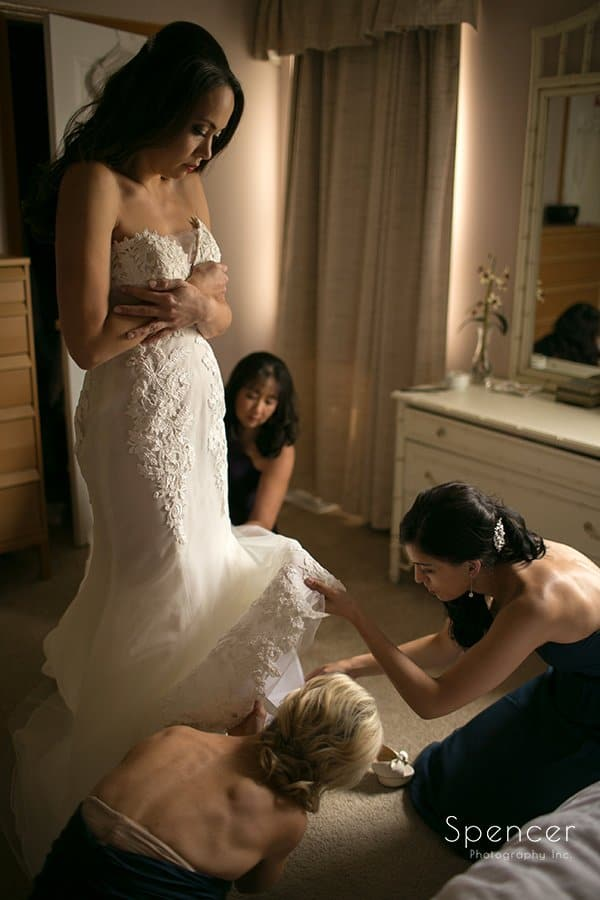bridesmaids helping bride prepare for her landerhaven wedding