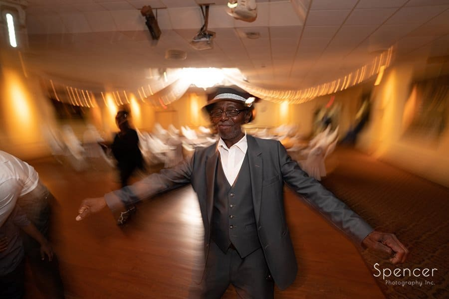 guest of honor dancing at his party at Sherwin Gilmore event center