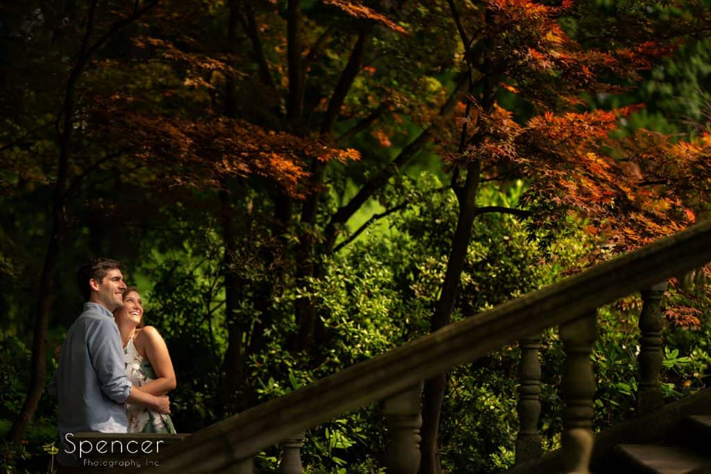 couple hugging during engagement pictures at Stan Hywet Hall and Gardens