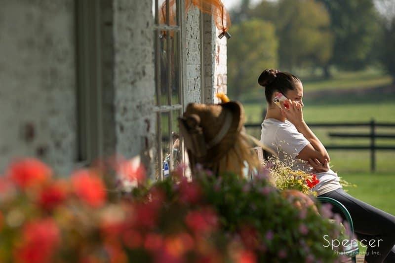 bridesmaid on phone on wedding at Brookside Farm