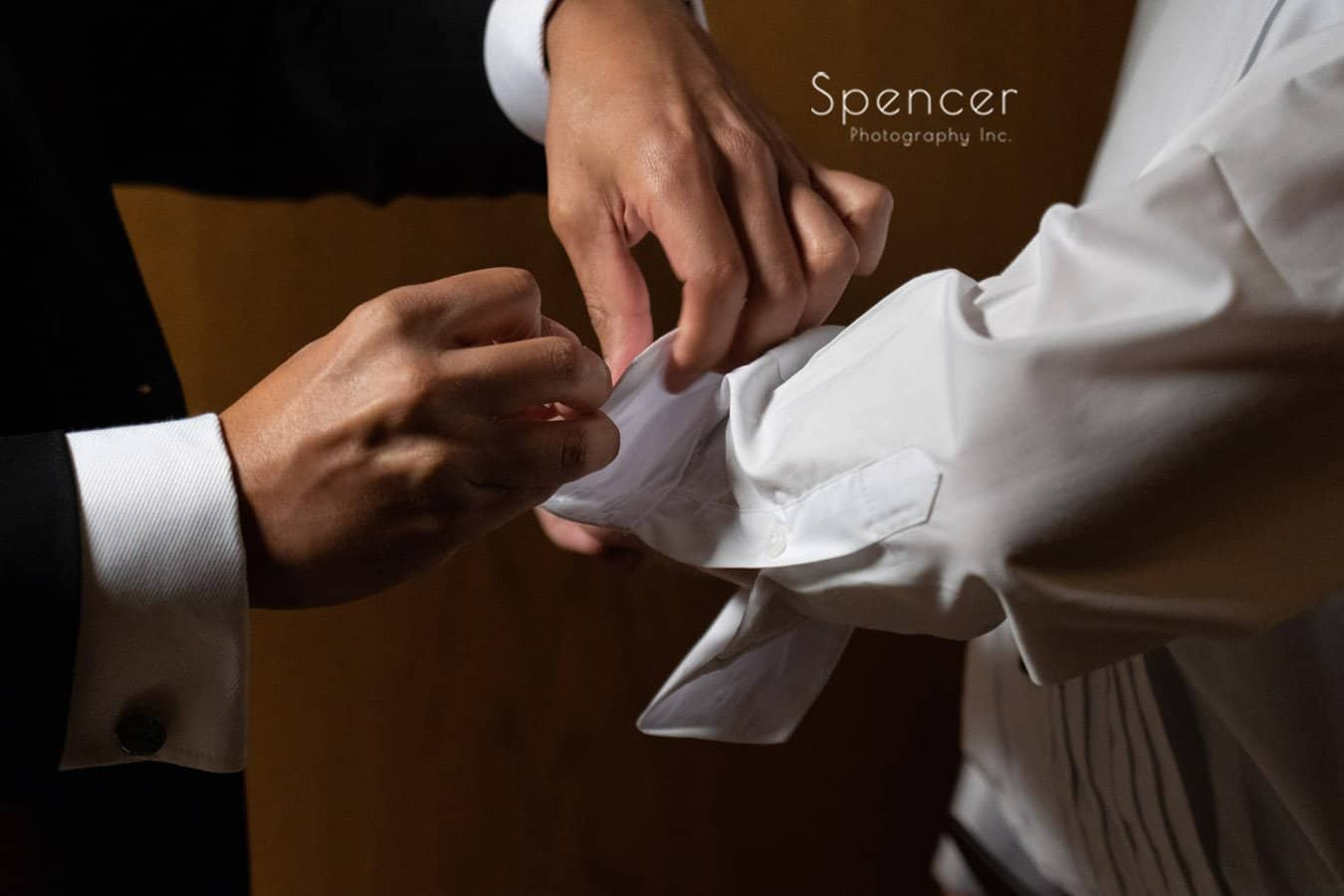 best man helping groom with custom cuff links
