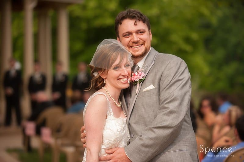 bride and groom smile after their wedding ceremony