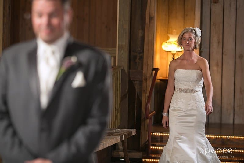 bride walking up to groom on wedding day at Brookside Farm