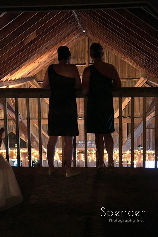 bridesmaids watching wedding ceremony at Brookside Farm