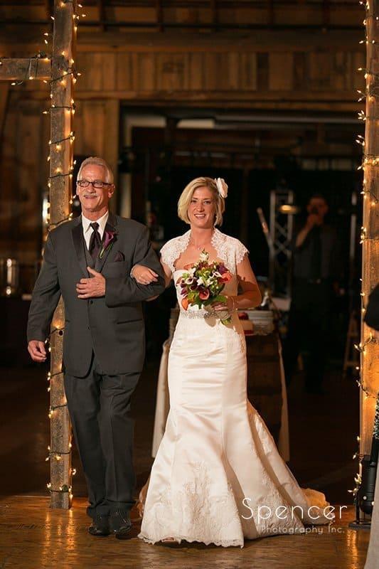 dad walking dad to wedding ceremony at Brookside Farm