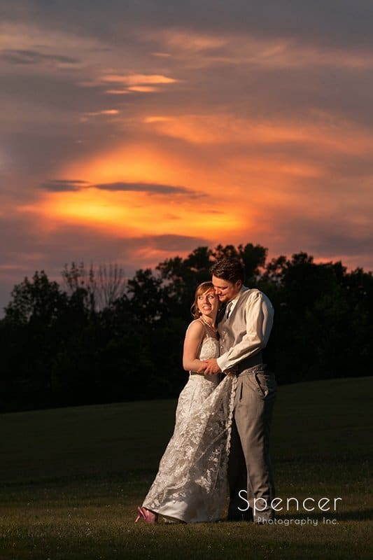 sunset picture of bride and groom at Caro's party center