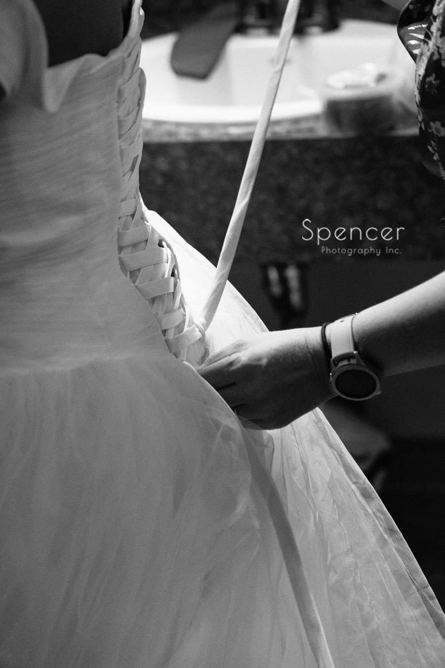 wedding dress getting laced up at Oberlin wedding
